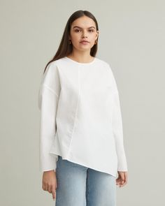 Asymmetric blouse with round neckline, long sleeves and dropped shoulders. Crisp cotton Long sleeves Dropped shoulders Diagonal seam at front and back Loose and boxy cut cotton Model is ft 9 in and is wearing a size S Apothecary, Designing Women, Blouse, Neckline, Long Sleeve, Sleeves, Model, Cotton, How To Wear