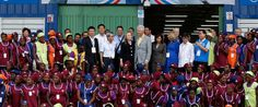 Headline: In Haiti, A Factory Where Big Money, State Department, and the Clintons Meet Caption: Hillary Clinton and Bill Clinton (center) pose with workers at the grand opening ceremony of the new Caracol Industrial Park in Caracol, Haiti, Oct. 22, 2012. URL: http://abcnews.go.com/Politics/haiti-factory-big-money-state-department-clintons-meet/story?id=42729714