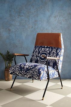 Something like this that is more modern to create tension in opposition to the couch, could even stay in the blues to 'match' sofa ......via #Anthropologie