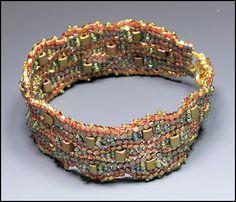 Flat Undulating Herringbone Also called Ndebele.  It teaches how to make increases between columns.