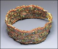 Whimbeads - Flat Herringbone with inserts.  full instructions w/good pictures. #Seed #Bead #Tutorial #bracelet - since this is from an online store, specific bead colors are given for exact replication.