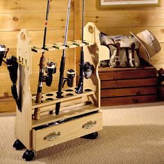 Keep your rods upright and the lines untangled with the rolling Fishing Rod Rack. This wooden organizer holds up to 12 rods