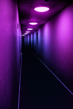 USA MOTEL is told in color and shadows -- The ominous colors are mirrored throughout the entirety of the hallway, slowly transitioning from neon purples, to blue, and then black. Neon Purple, Purple Rain, Shades Of Purple, Black Neon, Bright Purple, Neon Colors, Purple And Black, Magenta, Neon Noir