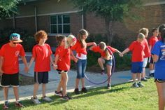 Form two or more groups and have them hold hands down a straight line. The goal of the game is to get the Hula Hope from one end of the line to the other without the group letting go of their human chain. The first team to get their Hula Hoop to the end of the line wins!