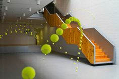 2,000 Suspended Tennis Balls Appear to Bounce Through Mustang Art Gallery by Ana Soler