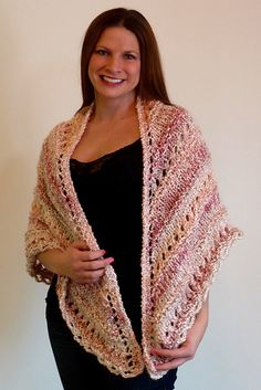 "This is a lacy knit shawl that adds warmth by alternating rows of lacy knit with the basic stockinette stitch. The shawl measures approximately 32"" down the center back and 64"" across the upper edge and should fit most women. You could make it smaller by eliminating the last pattern section, or larger by adding a pattern section."