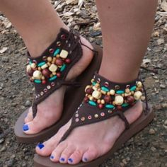 Refashion an old t-shirt and plastic flip flops into a fun tribal style sandal! Embellish with wood beads, plastic beads, and gems.