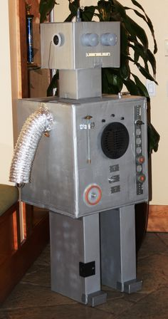 Greeter-bot.....his ears are speakers attached to an ipod on his neck.  He played the party tunes for us, a mix of robot music we downloaded from itunes. - Robot Birthday Party #robot #robotparty