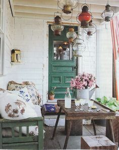 """vintagecottagefrench: """" I love the boutquet of pink flowers in an old metal watering can. And the beautifully painted green door. And the hanging lanterns and the pillows. Ideas for my sun porch. Outdoor Rooms, Outdoor Living, Boho Home, Bohemian Porch, Porch Decorating, My Dream Home, Interior And Exterior, Interior Design, Living Spaces"""