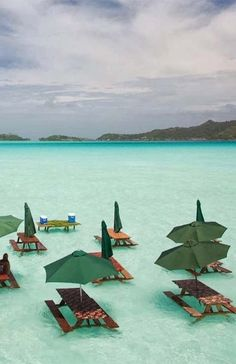 Picnic tables in the ocean of Bora Bora