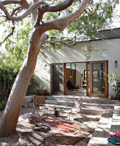 Backyard space with sliding wood doors