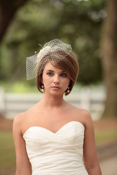 Love, love, LOVE her veil!!! and her haircut!