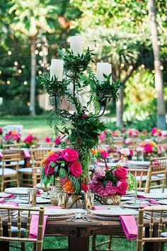 Hot pink roses and climbing vine candelabras with gold Chiavari chairs at a Disneyland wedding reception