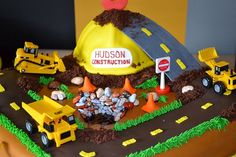 An awesome construction cake, everything but the trucks and sign are fondant!