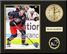 One 8 x 10 inch Columbus Blue Jackets photo of Derick Brassard inserted in a gold slide-in frame and mounted on a 12 x 15 inch solid black finish plaque.  Also features a 3-inch Arabian gold-faced clock, a customizable nameplate* and a 2-inch hockey medallion with a gold base. $59.99 @ ArtandMore.com
