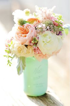 Mint painted mason jar with beautiful flowers. LOVE this for our centerpiece on the dining table. Would look gorgeous against the color of table we have.