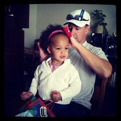 Father doing his African American/white daughters hair... he's getting there :)