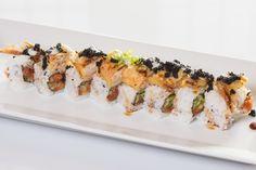 Black Spider($11.95) - Spicy tuna, cucumber topped w/soft shell crab, tobiko, unagi & wasabi mayo sauce