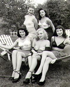 C.1950s odd found photo of women in bra lingerie sitting on a hammock outside