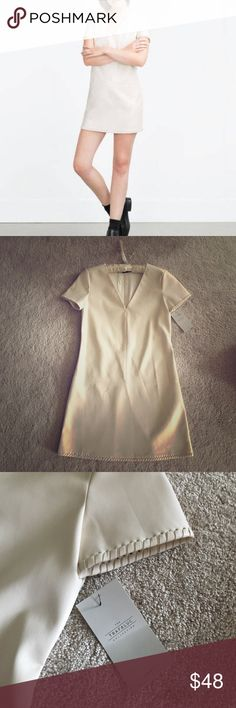 ZARA leather dress size S Beautiful creme colored dress from Zara. New with tags, never got a chance to wear so letting it go. Flattering cut and shape true to size small. Material might be faux leather, doesn't say but it is very soft and comfortable to wear. Length 32 inches from top to bottom. Zara Dresses Mini