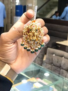 Beautiful gold lord Ganesha pendant with emerald and guttapusalu hangings. Coral Jewelry, Beaded Jewelry, Pendant Jewelry, Diamond Jewelry, Ruby Necklace Designs, Marriage Jewellery, Ganesh Pendant, Locket Design, Gold Pendent