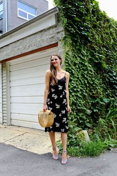 Don't know what to wear to a fall wedding? Check out this black flower patterened B.P. dress paired with light blue Steve Madden shoes and a cult gaia ark bag.