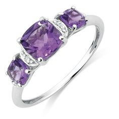 Add some color to your outfit with this stunning amethyst and diamond 10kt white gold ring. 3 claw-set, lustrous purple stones sit aside sparkling diamonds atop a white gold band.