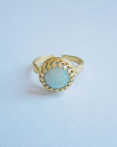 "Priya, meaning ""beloved"", features a a pale greeny-blue Amazonite cabochon set inside a golden brass ring. Amazonite, known as the Stone of..."