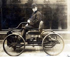 Henry Ford in his first automobile