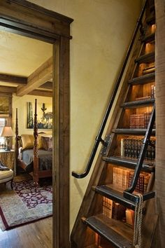 Bookcase stairs - This only looks feasible for a loft room or mezzanine area. Looks brilliant though; I like the cast iron look banister and step grips/guards.