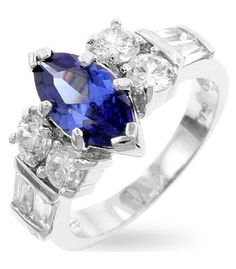 Jewelry| Marquise Tanzanite Cubic Zirconia Crowned Ring Genuine Rhodium Plated Marquise Tanzanite Purple Cubic Zirconia Crowned Ring Between a Pair of Round Prong Set Cubic Zirconia and Emerald Cut Cubic Zirconia Polished into a Lustrous Silvertone Finish. $24.00