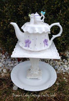 A personal favorite from my Etsy shop https://www.etsy.com/listing/270821956/teapot-whimsy-birdbath-birdfeeder-garden