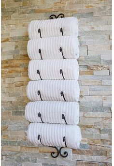 Great idea. Wine rack repurposed as a towel holder.