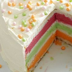 Layered Sherbet Cake - One bite of this chilly cake will take you back to the fun flavors of childhood push-up pops. Our layered spin features rows of lime, raspberry, and orange sherbet between soft vanilla cake. (And we snuck in a few candy toppers, too!)