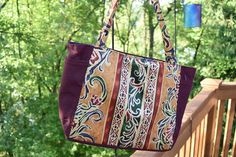 Check out this item in my Etsy shop https://www.etsy.com/listing/239617315/8-pocket-handbagbali-style-fabric-maroon