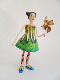 Whirligig. Cartapesta and air dry clay sculpture.