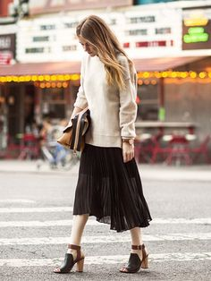 Neutral sweater + pleated black skirt and strappy sandals