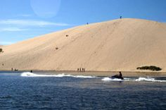 Silver Lake Sand Dunes Midwest, this strip along Lake Michigan—encompassing the towns of Hart, Mears, and Pentwater—massive sand dunes, beach buggies, and farmers' markets along with over-the-top July 4th fireworks.