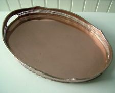 Vintage 2 handled copper tray with 4 feet and pierced gallery