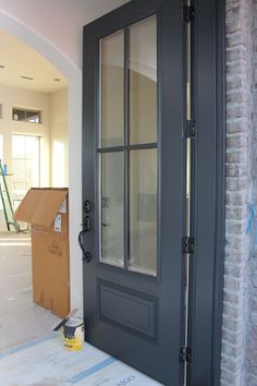 Door painted in Benjamin Moore Wrought Iron. One of the best dark door and trim … Door painted in Benjamin Moore Wrought Iron. One of the best dark door and trim colors. by alisha - Door Updating House, House Exterior, House Design, Front Door, Dark Doors, New Homes, House Colors, Door Paint Colors, Luxury Interior Design