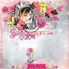 """Congrats to stellamarie for her layout, """"I Love My Life!"""" I love every single artistic detail from the crown over her photo to the sweet little border along the bottom edge. She combined papers and a painted border to create a stunning background, and perfectly clustered the paper blocks and elements without taking the focus away from her beautiful photo. I am just amazed at pages like this that have such depth, but don't feel like the elements are floating over the page....amazing shadow…"""
