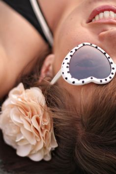heart sunglasses & hair flowers.