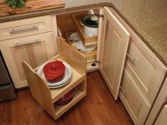 Merillat Cabinets' swing out pantry- OMG SO PERFECT FOR CORNER!!!! No more dead space! No more crawling into the cabinet for that one dish that got pushed to back! I need this!