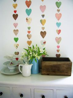 Pretty heart garlands by dotty angel (with a tutorial). - i love mine that i made last year! but this makes me want to update with new paper and colors...