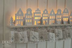 DIY: Advent calendars with illuminated mini-houses Deko-Kitchen Kitchen Crafts Simple Christmas, Christmas Crafts, Christmas Decorations, Holiday Decor, Xmas, Advent Calenders, Diy Advent Calendar, Little Houses, Mini Houses