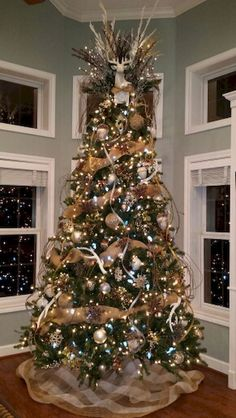 burlap christmas tree 30 Gorgeous Christmas Tree Decorating Ideas You Should Try This Year Burlap Christmas Tree, Woodland Christmas, Christmas Tree Themes, Noel Christmas, Christmas Tree Toppers, Xmas Decorations, White Christmas, Christmas Tree With Antlers, Country Christmas