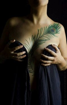 Chest tattoo peacock feather