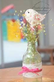 Resultado de imagem para garrafa reciclada para enfeite de mesa