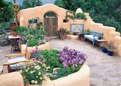 Susan Blevins of Taos, New Mexico, created an elaborate home garden featuring containers, perennial beds, a Japanese themed path and a regional style that reflects the Spanish and pueblo architecture of the area. Spanish Style Homes, Spanish House, Spanish Colonial, New Mexico Style, New Mexico Homes, Spanish Garden, Spanish Patio, Santa Fe Style, Adobe House