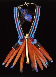 Brazil | Ceremonial necklace from the Urubu people | Money bone whistle, feathers, vegetal fiber: